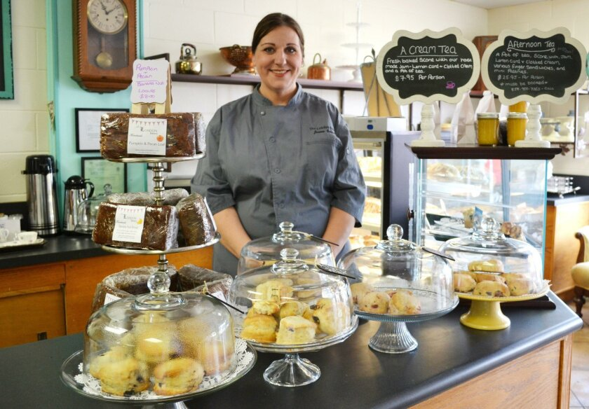 Joanne Bennett, owner of The London Bakery, stands behind displays of scones and breads.