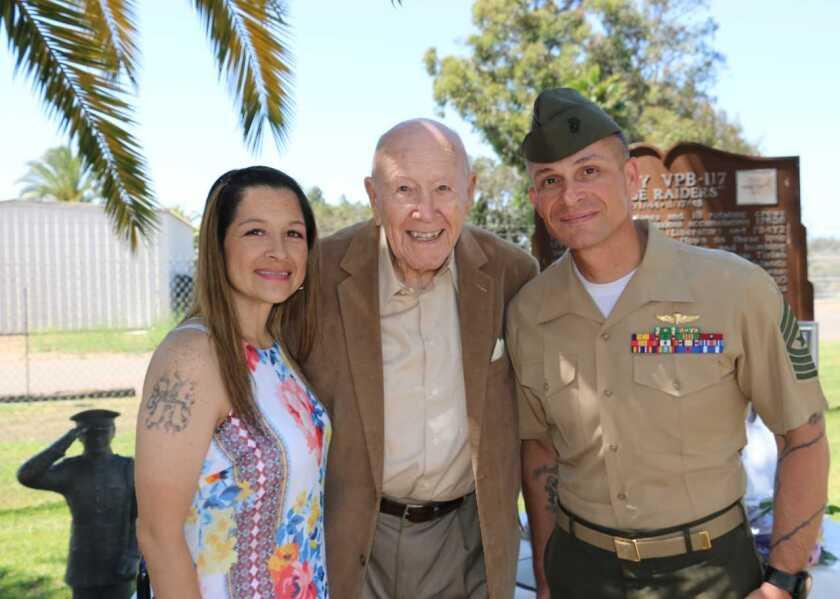 2018 Irene Ferguson Marine Wife of the Year awardee Traci Wilson with her husband, Sgt. Maj. Daniel Wilson. They are shown with Maj. Glenn Ferguson (center), the founder of the program.