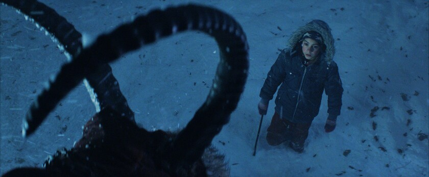 """Emjay Anthony comes face to face with Krampus in the film """"Krampus."""""""