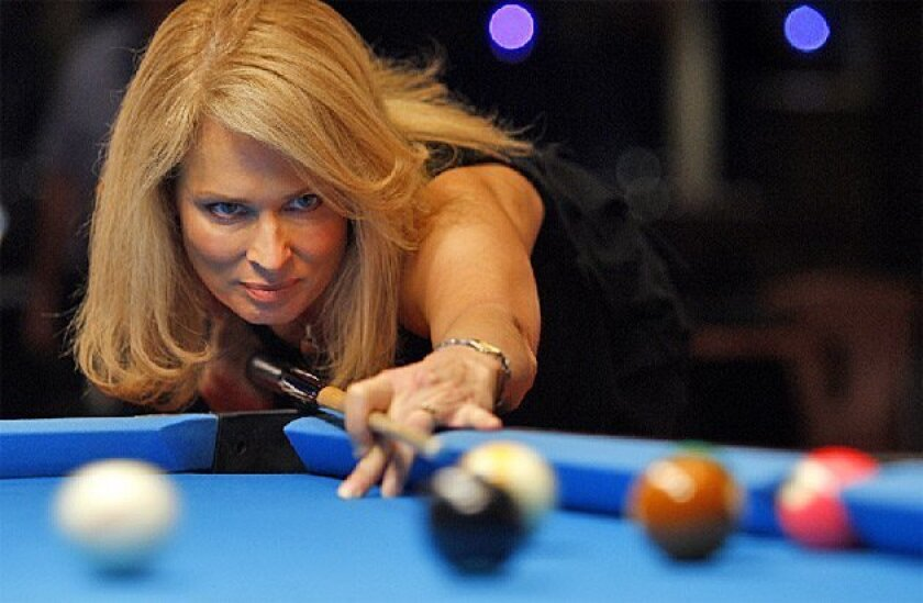 """Ewa Mataya Laurance, nicknamed """"The Striking Viking,"""" practiced for  the Women's Professional Billiard Association tournament taking  place at Viejas Casino this weekend. (K.C. Alfred /  Union-Tribune)"""