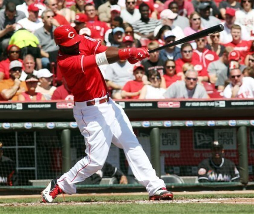 Cincinnati Reds' Brandon Phillips (4) gets his 1,000th career hit, in the second inning of a baseball game against the Miami Marlins on Sunday, April 9, 2012, in Cincinnati. (AP Photo/Ernest Coleman)