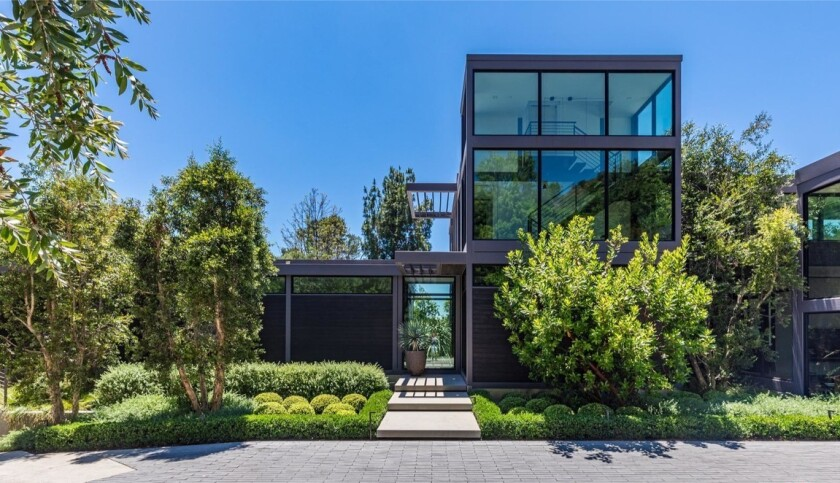 A metal and wood home with three-story atrium.