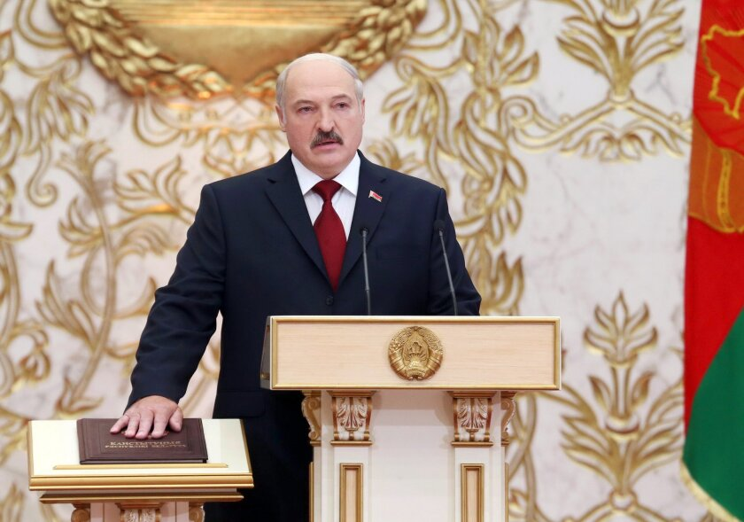 Belarusian President Alexander Lukashenko takes his oath of office during his inauguration ceremony at the Palace of the Independence in Minsk, Belarus, Friday, Nov. 6, 2015. The president of Belarus has taken the oath of office for a fifth term. (Nikolai Petrov, BELTA via AP)