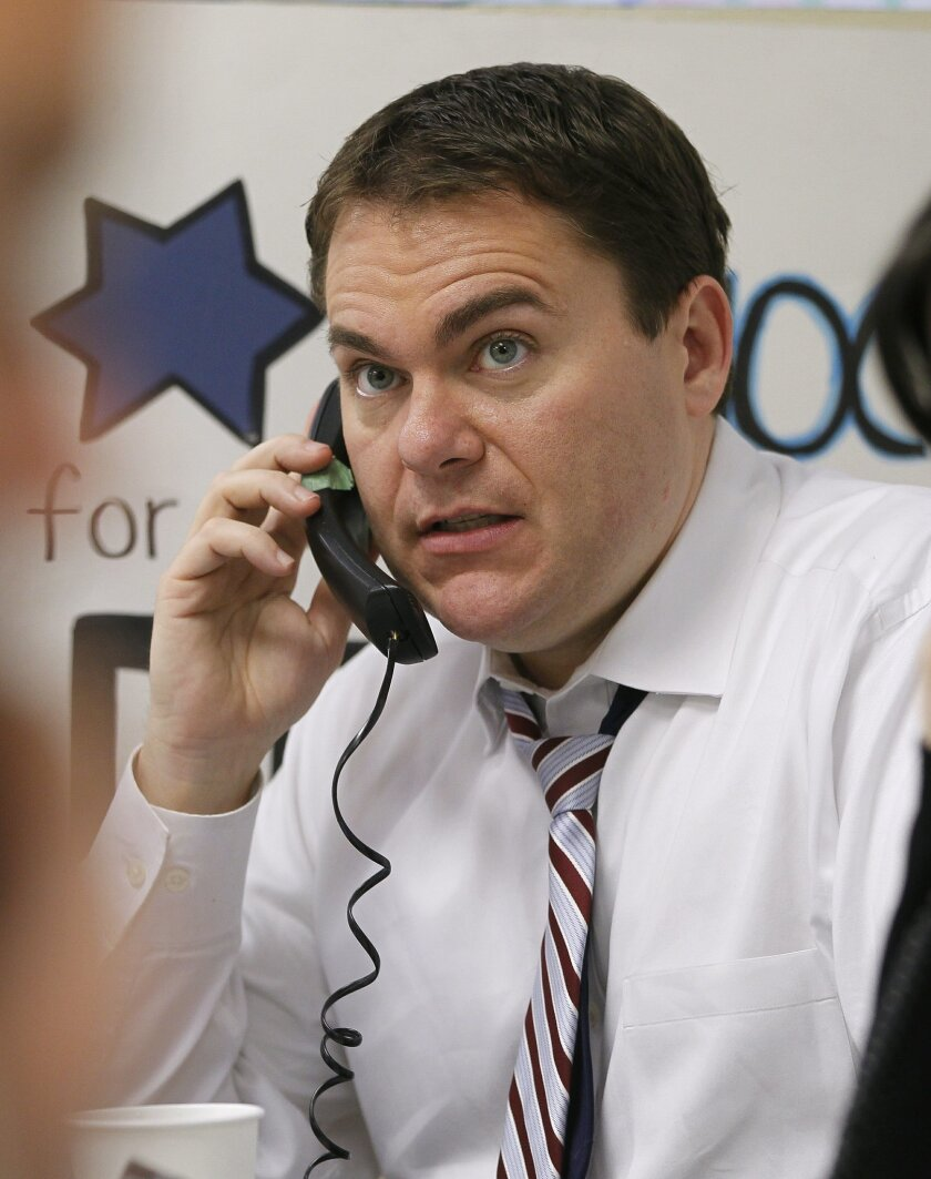 Congressional Carl DeMaio making phone calls to voters while at his campaign headquarters in San Diego last week.