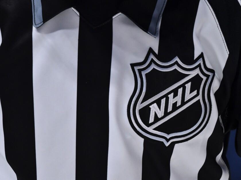 NHL logo on a referee's uniform.
