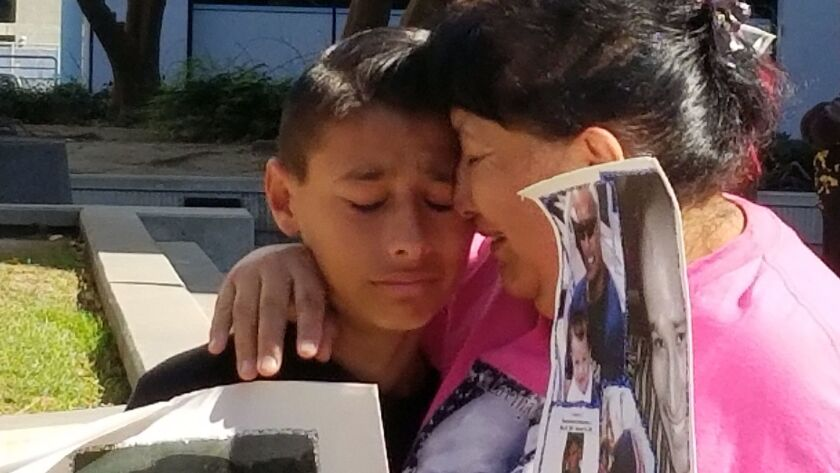Angel Hernandez, 12, and his grandmother Cathy Hernandez attended a press conference held by Crime S