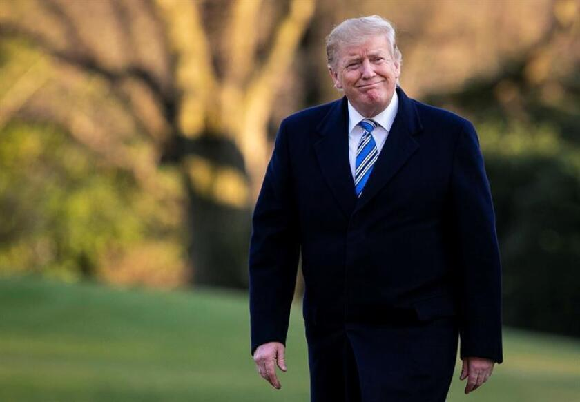 US President Donald J. Trump walks on the South Lawn of the White House, in Washington, DC, USA, 10 March 2019, after arriving aboard Marine One. EPA/EFE/POOL