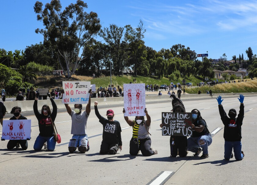 Protestors in support of calling for justice for George Floyd temporary blocked the westbound freeway lanes on Int. 8.