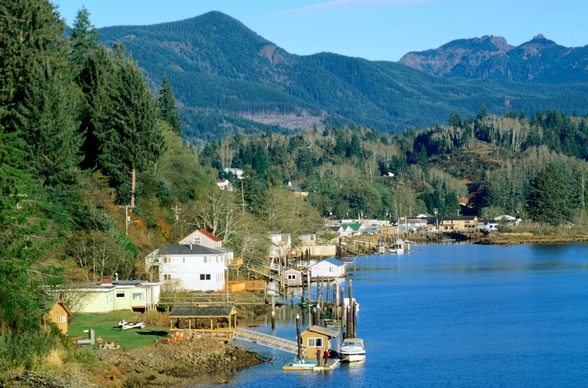 Peaks rise above the small township reaching heights of 3000 feet in Nehalem Bay, Oregon.