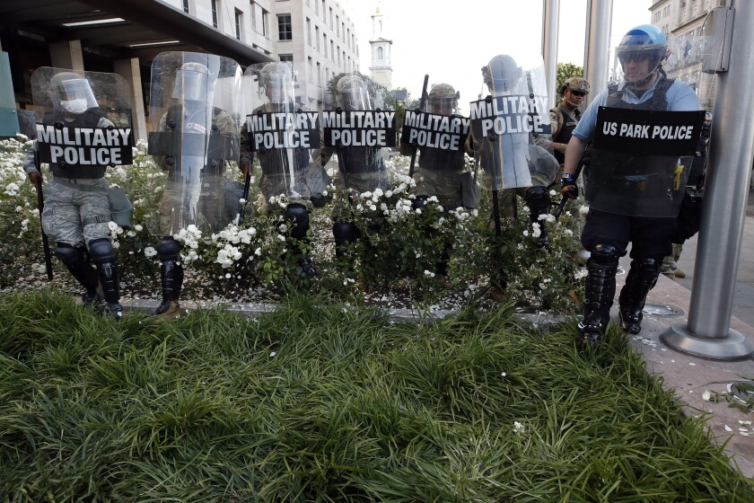 FILE - In this June 1, 2020, file photo police clear the area around Lafayette Park and the White House as demonstrators gather to protest the death of George Floyd in Washington. Floyd died after being restrained by Minneapolis police officers. (AP Photo/Alex Brandon, File)