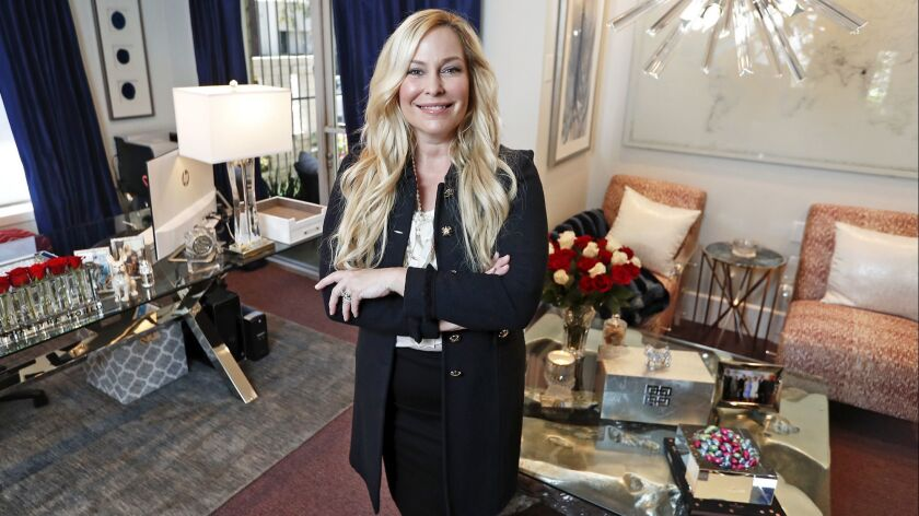 Robin Follman-Otta, CEO of R.A. Industries, LLC. in Santa Ana, poses for a portrait in her office.