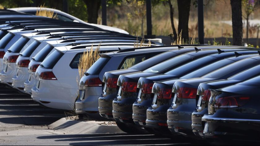 Volkswagen cars for sale are on display on the lot of a VW dealership in Boulder, Colo., Thursday, S