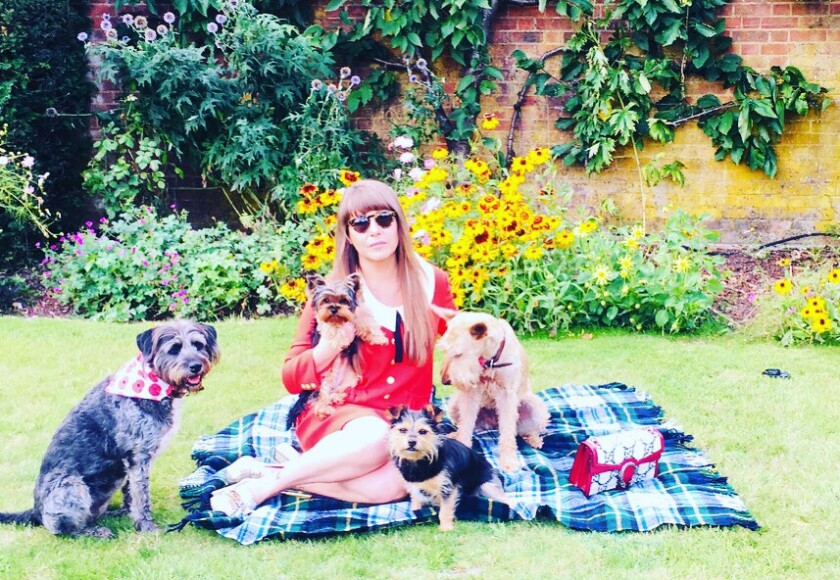 Composer Rachel Fuller, photographed with her current dogs.