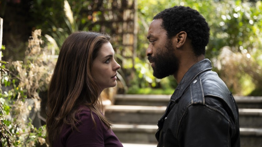 "Anne Hathaway and Chiwetel Ejiofor appear in a scene from Doug Liman's pandemic heist drama ""Locked Down."""