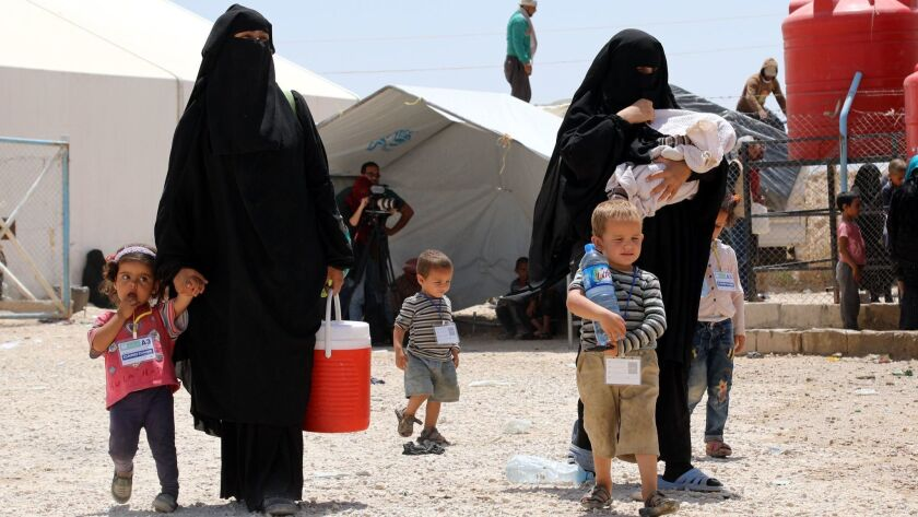 Kurdish authorities handing over 800 Syrian women and children to families from al-Hol camp, Hasakah, Syria - 04 Jun 2019
