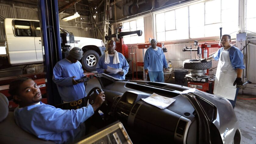 FOLSOM, CA - NOVEMBER 17, 2017 -- Inmates participate in an auto shop class at Folsom Prison in Fols