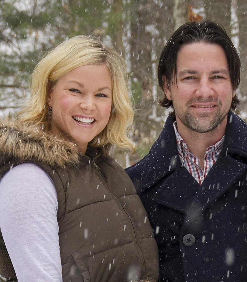 In this January 2014 photo, Thomas and Kelley Clayton pose in Caton, N.Y. Thomas Clayton, a former minor league hockey player has been charged with killing his wife inside their upstate New York home, authorities said. The Steuben County sheriff's office said deputies and state troopers responded to Thomas Clayton's home in Caton, near the Pennsylvania border, after he called 911 early Tuesday, Sept. 29, 2015, and said he found his wife dead. (Jeff Richards/The Star-Gazette via AP) CORNING OUT; NO SALES; MANDATORY CREDIT