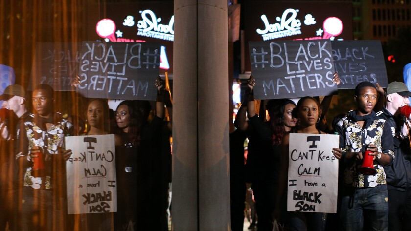 Protesters march Saturday in Atlanta in response to police shooting deaths in Tulsa, Okla., and Charlotte, N.C.
