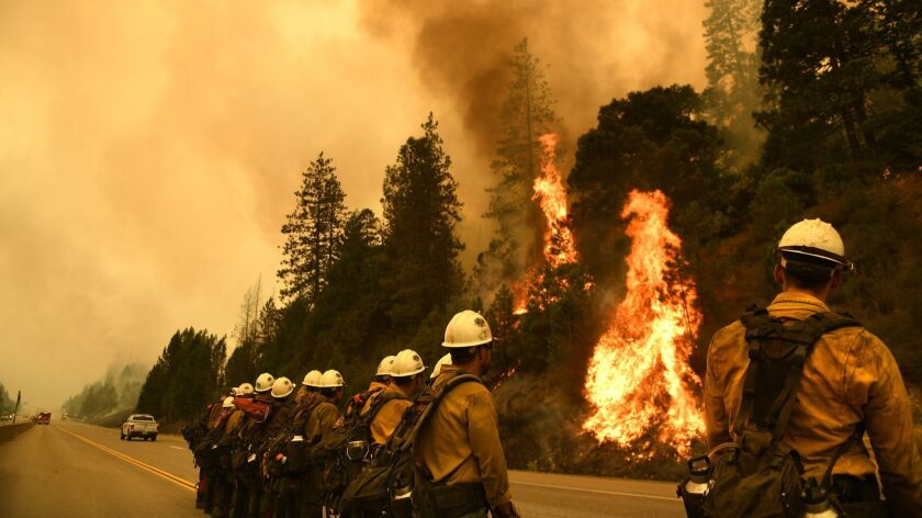 SHASTA COUNTY, CALIFORNIA SEPTEMBER 7, 2018-Firefighters monitor the Delta Fire along Interstate 5 n