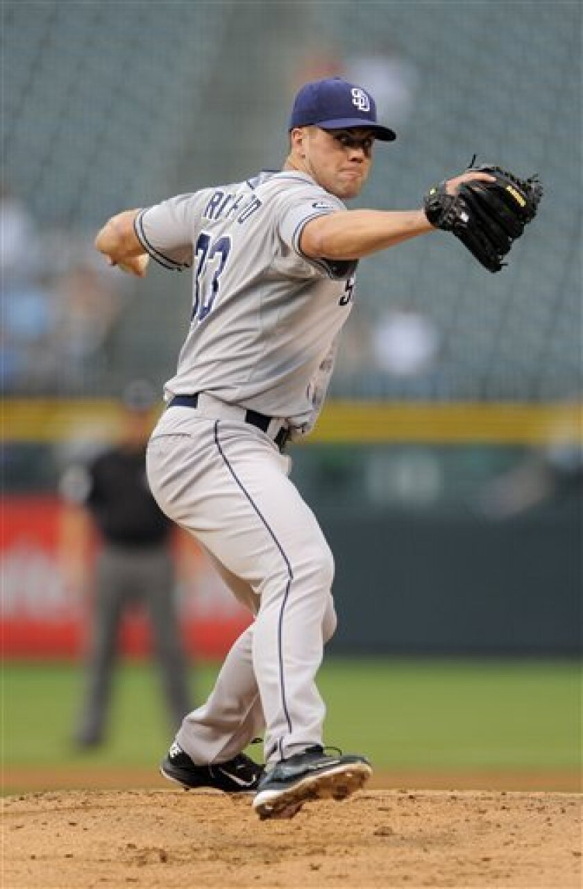 San Diego Padres starting pitcher Clayton Richard throws against the Colorado Rockies during the first inning of a baseball game on Friday, Aug. 31, 2012, in Denver. (AP Photo/Jack Dempsey)