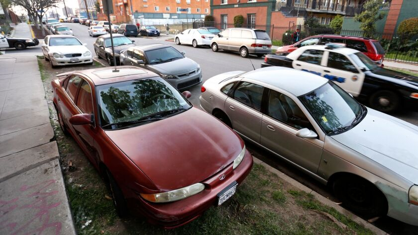 You may soon no longer be able to park between the sidewalk