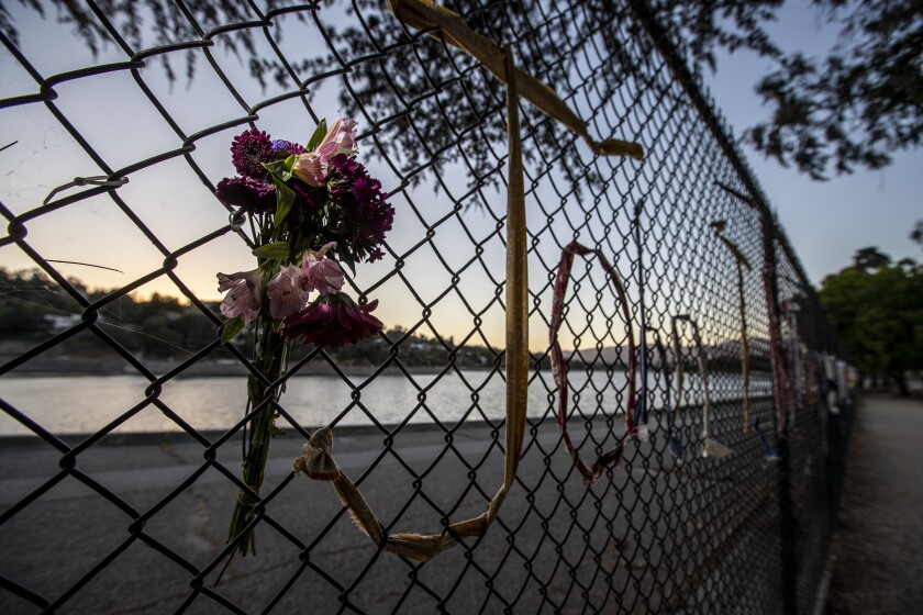 Fresh flowers in the fence memorial.