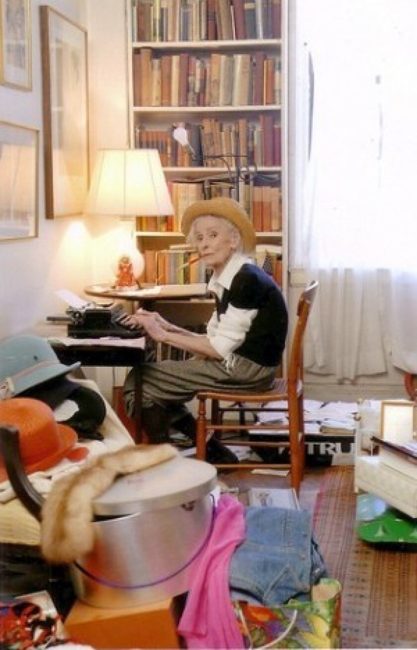 "In the 2008 movie ""Hats off,"" Mimi Weddell sits at her desk. The documentary profiles the beauty and eccentricities of an extraordinary whose full-time acting career began at age 65."