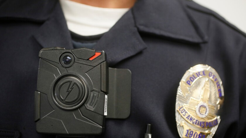 A Los Angeles Police officer wears a body camera during a demonstration of the devices in January of 2014.