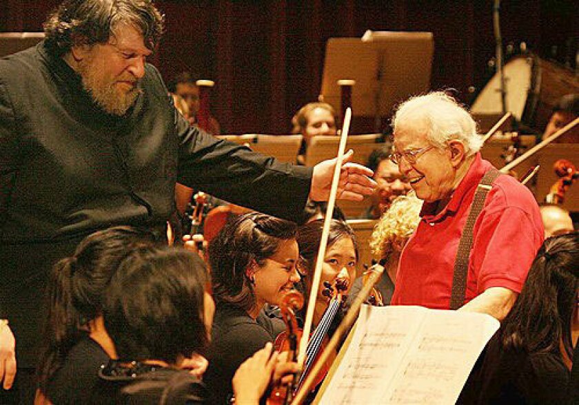 Conductor Oliver Knussen leads Elliott Carter onstage at the Tanglewood Music Center.