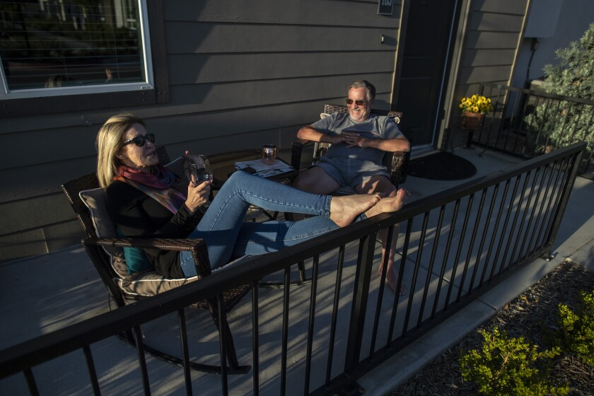 Bree McDowell, left, and Bill Van Heusen, right, enjoy the sunset from their patio.
