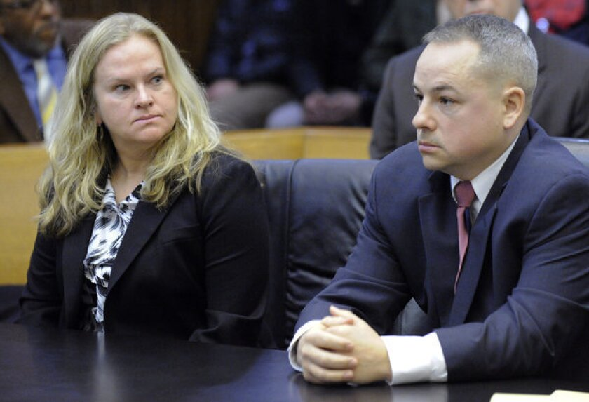 """Joseph Weekley, right, attended a Detroit court hearing in March. At left is A&E producer Allison Howard, who was at the raid for the reality series """"The First 48."""""""