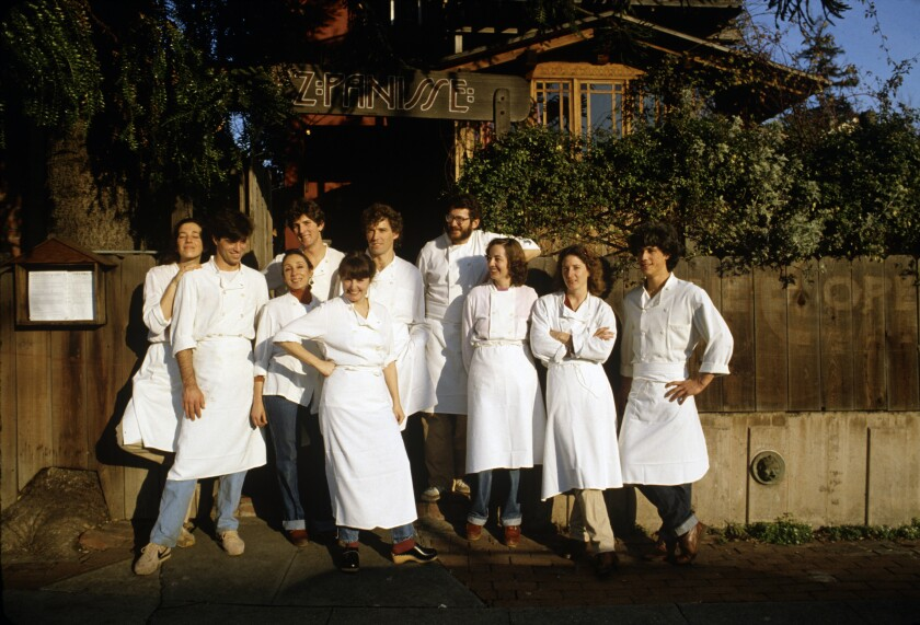 Alice Waters (center) poses outside Chez Panisse with her kitchen staff in 1982. (Photo by Susan Wood/Getty Images)