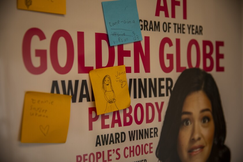 "A ""Jane the Virgin"" poster with Gina Rodriguez's face and sticky notes on it."