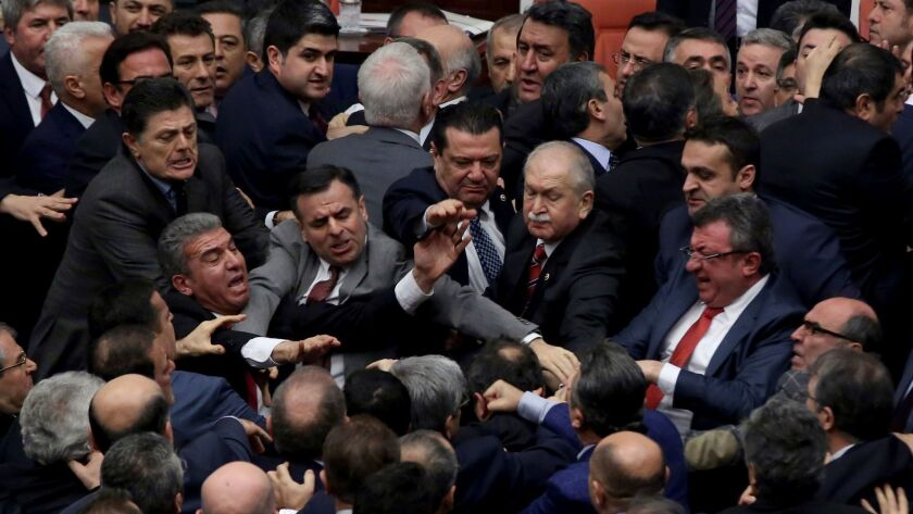 Ruling Justice and Development Party and main opposition Republican People's Party legislators scuffle in Turkey's parliament during deliberations over a controversial package of constitutional amendments, in Ankara, Turkey, on Jan. 11, 2017.