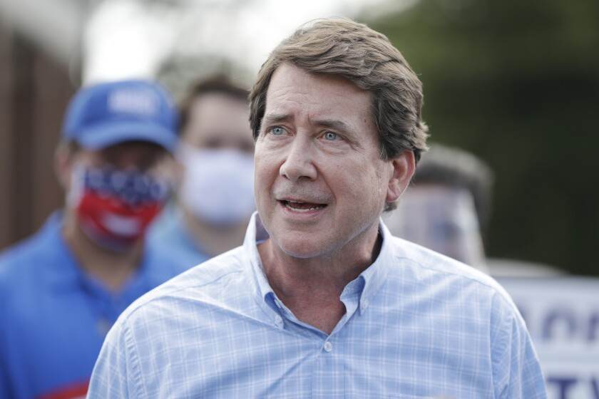 Former U.S. Ambassador to Japan Bill Hagerty speaks at a polling place Thursday, Aug. 6, 2020, in Brentwood, Tenn. Hagerty and Dr. Manny Sethi are competing to become the GOP nominee in the race to replace retiring Republican Sen. Lamar Alexander. (AP Photo/Mark Humphrey)