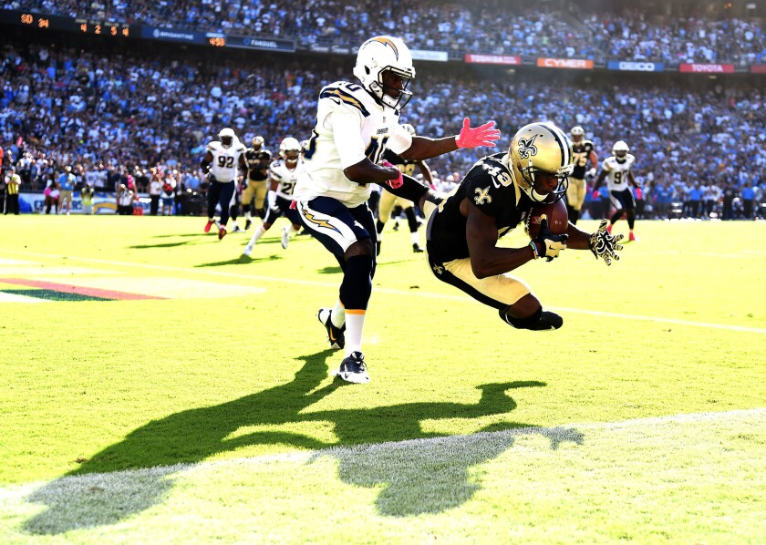 Saints receiver Michael Thomas (13) makes a catch for a touchdown in front of Chargers defensive back Pierre Desir (40) late in the fourth quarter.