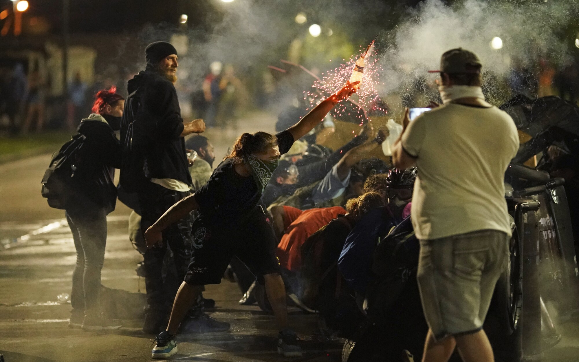 A protester tosses