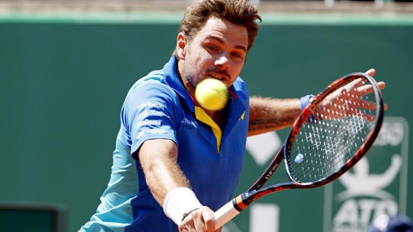 Stan Wawrinka volleys a shot against Mischa Zverev on Saturday in the Geneva Open championship match.