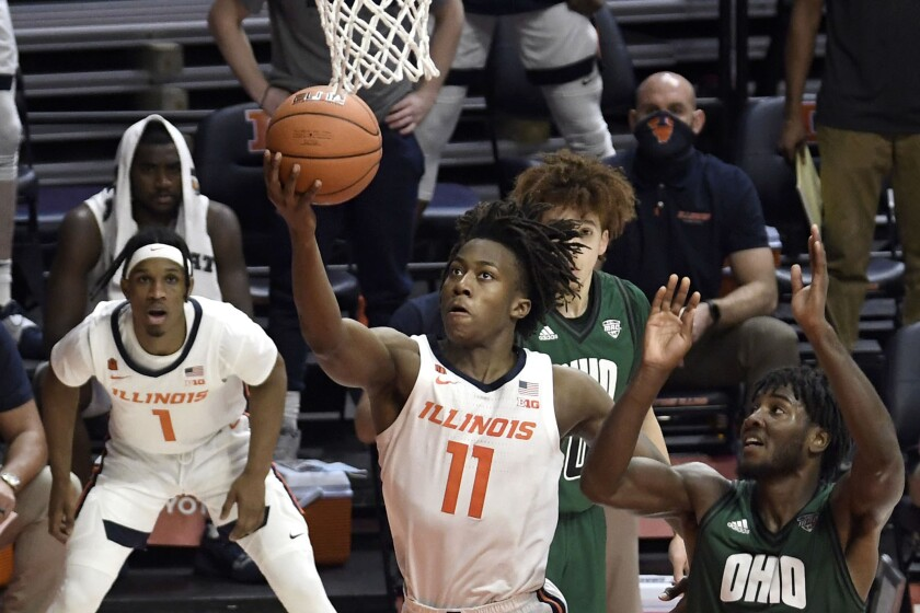 Illinois guard Ayo Dosunmu (11) shoots as Ohio guard Lunden McDay (15) defends in the second half of an NCAA college basketball game Friday, Nov. 27, 2020, in Champaign, Ill. (AP Photo/Holly Hart)