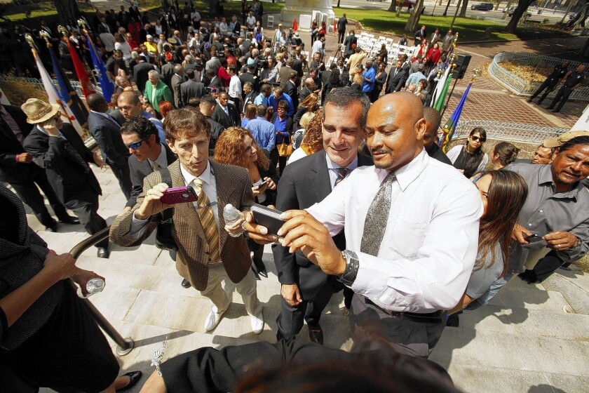 "B.J. Hawke, a Desert Storm Army veteran who is looking for a job, takes a selfie with L.A. Mayor Eric Garcetti after the announcement of the ""10,000 Strong"" hiring initiative for veterans."