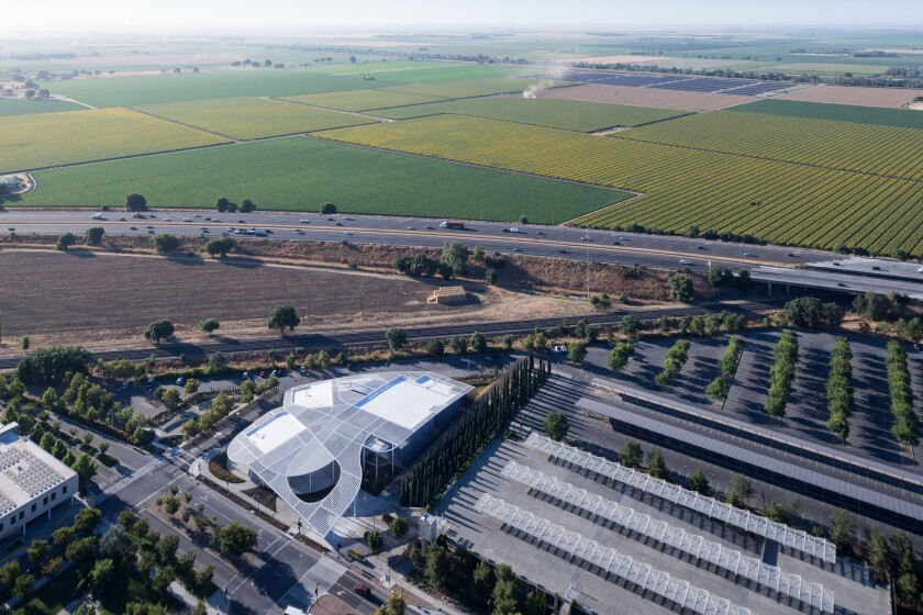 Aerial view of the museum, with train tracks, Interstate 80 and farmland in the distance.