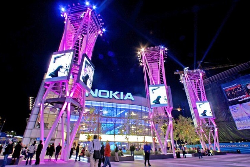 Moving images on video screens in front of the Nokia Theatre in downtown L.A. draw eyes away from the buildings.
