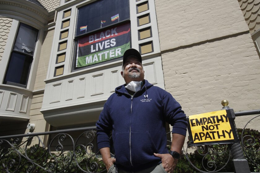James Juanillo poses outside his home in San Francisco