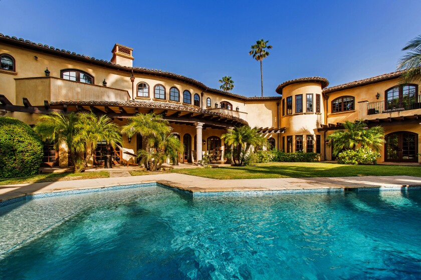 Swimming pool and an exterior view of Milton Bradley's former Encino home