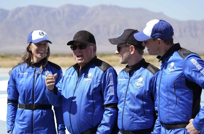 William Shatner, center right, speaks  during a media availability at the Blue Origin spaceport near Van Horn, Texas, Wednesday.
