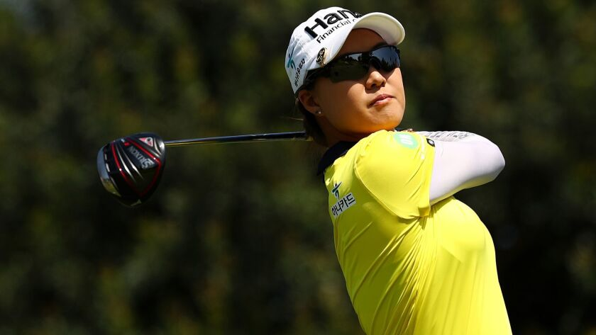 Minjee Lee plays her shot from the sixth tee during round two of the Hugel-Air Premia L.A. Open at Wilshire Country Club on Friday.