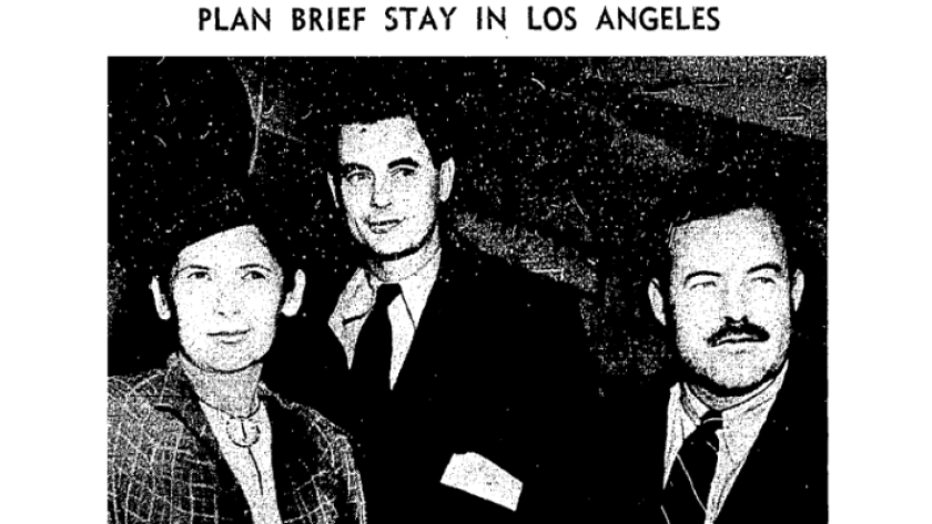 The L.A. Times wrote about the arrival of Ernest Hemingway, right, Joris Ivens and Mrs. Hemingway (P