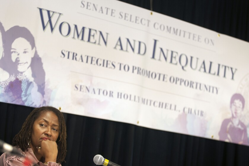State Sen. Holly J. Mitchell listens to speakers during a hearing by the state and federal legislators on women and inequality on October 22, 2014. Mitchell's bill prohibiting the use of grand juries in cases of police-involved deaths passed the Senate on Thursday.