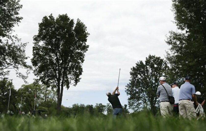 Rod Perry hits off the 11th tee during a practice round for the PGA Championship golf tournament at Oak Hill Country Club, Tuesday, Aug. 6, 2013, in Pittsford, N.Y. (AP Photo/Charles Riedel)