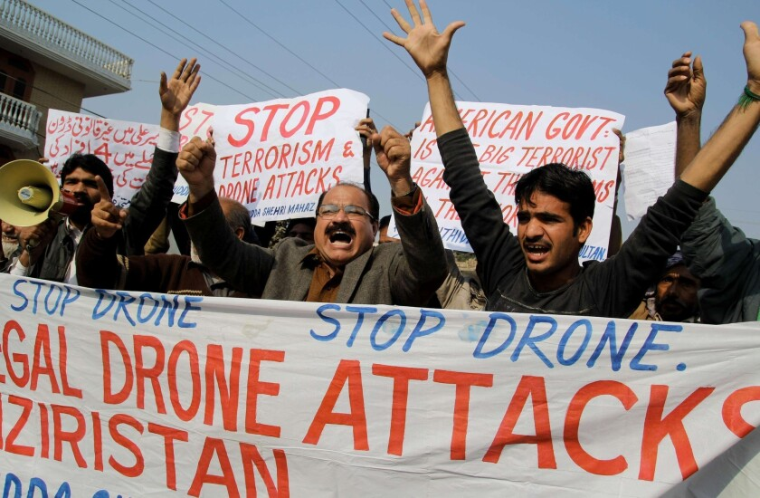 Pakistani activists shout slogans in December as they protest a U.S. drone attack in the town of Multan. The drone campaign is deeply unpopular in Pakistan.